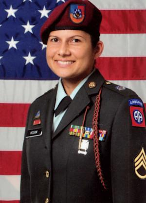"""CORRECTS CHANGED NAME TO NAIDA CHRISTIAN NOVA, NOT NADIA CHRISTIAN NOVA - Sgt. 1st Class Naida Hosan is shown in this undated U.S. Army photo provided by Sgt. Nova. With her family name emblazoned on her uniform, the sergeant says she was routinely the target of derogatory remarks from other soldiers who mistakenly assumed she is a Muslim. So before deploying for her second war tour, the life-long Catholic legally changed her name to Naida Christian Nova. The 82nd Airborne, who in a federal lawsuit she claims branded her a """"Muslim sympathizer,"""" revoked her security clearance and tried to force her out of the Army with a less than honorable discharge. (AP Photo/US Army)"""