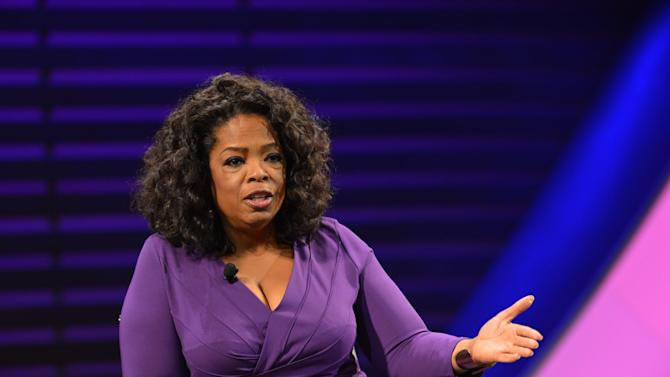 """This image released by the  Women in the World Conference OWN CEO Oprah Winfrey, during a panel discussion called """"Oprah: Meet My Hero,"""" at the 2013 Women in the World Summit in New York. (AP Photo/Women in the World Conference, Marc Bryan-Brown)"""