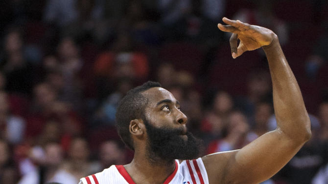 Houston Rockets' James Harden signals to the crowd after shooting a 3-point basket during the first quarter of an NBA basketball game against the Golden State Warriors, Tuesday, Feb. 5, 2013, in Houston. (AP Photo/Dave Einsel)
