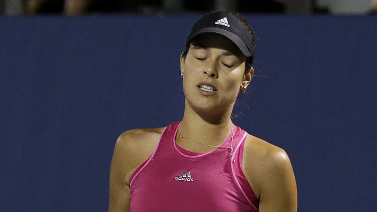 Ana Ivanovic, from Serbia, reacts after losing a point to Serena Williams during the third set of their match in the Bank of the West Classic tennis tournament in Stanford, Calif., Friday, Aug. 1, 2014. Williams won 2-6, 6-3, 7-5. (AP Photo/Jeff Chiu)