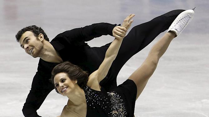 Duhamel and Radford of Canada compete during the pairs free skating program at the ISU World Team Trophy in Figure Skating in Tokyo