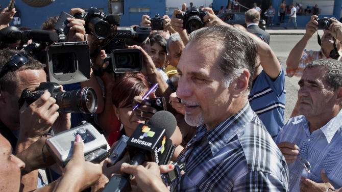 Rene Gonzalez speaks to reporters after leaving the U.S. Interests Section after starting paperwork to his renounce his U.S. citizenship in Havana, Cuba, Monday, May 6, 2013.  Gonzalez, a Cuban spy who spent 13 years in a U.S. prison, renounced his American citizenship Monday, part of a deal that allows him to avoid returning to the United States to serve out the remainder of his probation. (AP Photo/Ramon Espinosa)