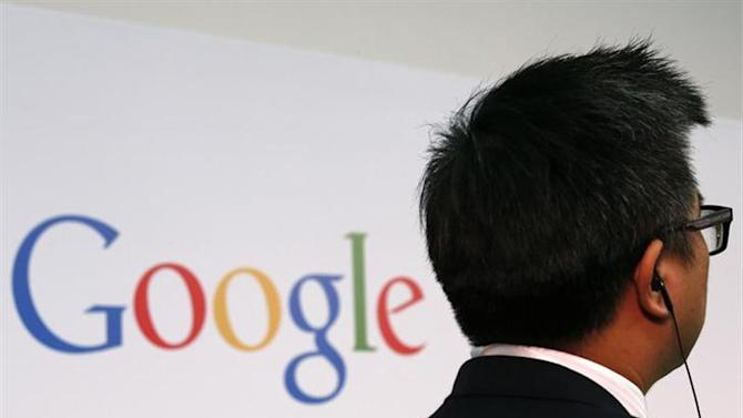 A man stands in front of a Google logo at the Chinese University of Hong Kong November 4, 2013. REUTERS/Bobby Yip