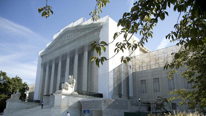 FILE - This Oct. 1, 2012 file photo shows the Supreme Court in Washington. The Supreme Court appears likely to rule that law enforcement must usually seek a search warrant before ordering a blood test for an unwilling drunken-driving suspect.  (AP Photo/Carolyn Kaster, File)