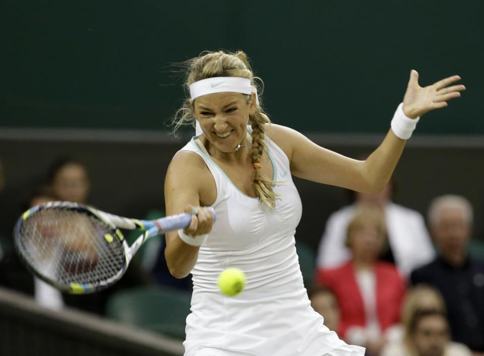 Victoria Azarenka of Belarus plays a return to Tamira Paszek of Austria during a quarterfinals match at the All England Lawn Tennis Championships at Wimbledon, England, Tuesday, July 3, 2012. (AP Photo/Anja Niedringhaus)