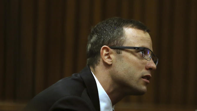 Oscar Pistorius sits in the dock at a court in Pretoria, South Africa, Monday, April 7, 2014. The defense in the Pistorius murder trial has opened its case, calling a pathologist as its first witness. Prof. Jan Botha was testifying Monday following four weeks of prosecution-led testimony and a week's adjournment after one of the judge's aides fell ill. Pistorius is charged with murder for the shooting death of his girlfriend Reeva Steenkamp, on Valentines Day 2013. (AP Photo/Themba Hadebe, Pool)