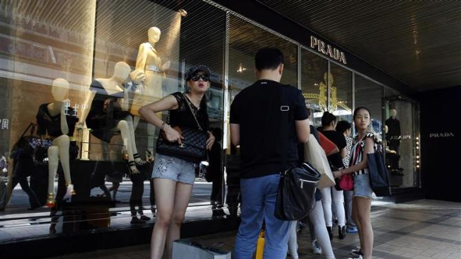 Mainland Chinese customers line up outside a Prada store at Hong Kong's shopping Tsim Sha Tsui district