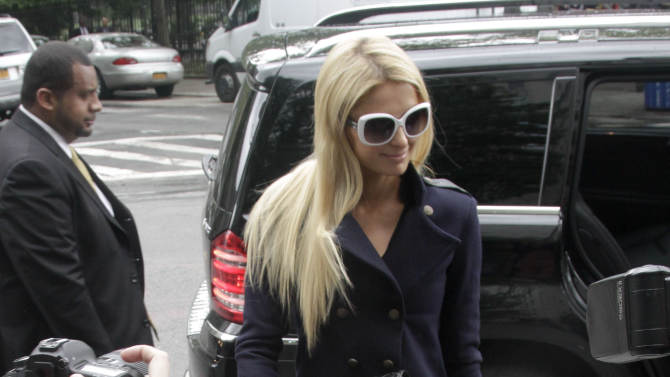 Paris Hilton arrives at federal court in lower Manhattan on Monday, June 4, 2012, in New York. Hilton was in court for settlement talks with an Italian designer that sued her over a licencing agreement to market lingerie under her name. The suit, for unspecified damages, alleges Hilton hurt business by not approving design concepts in a timely manner. (AP Photo/Bebeto Matthews)