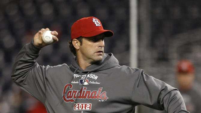 St. Louis Cardinals manager Mike Matheny throws during batting practice before Game 5 of the Cardinals' National League division baseball series against the Washington Nationals on Friday, Oct. 12, 2012, in Washington. (AP Photo/Pablo Martinez Monsivais)