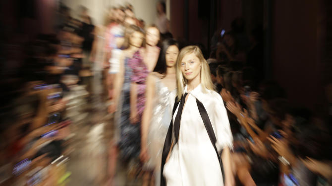 Models wear creations for Andrea Incontri women's Spring Summer 2015 collection, part of the Milan Fashion Week, unveiled in Milan, Italy, Wednesday, Sept. 17, 2014. (AP Photo/Antonio Calanni)