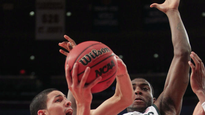 Duke's Austin Rivers (0) drives past Michigan State's Branden Dawson (22) during the first half of an NCAA college basketball game Tuesday, Nov. 15, 2011, in New York. (AP Photo/Frank Franklin II)