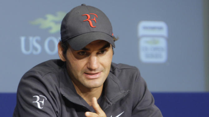 Roger Federer, of Swizterland, gestures while speaking during a news conference of the U.S. Open tennis tournament, Saturday, Aug. 27, 2011 in New York.  (AP Photo/Frank Franklin II)