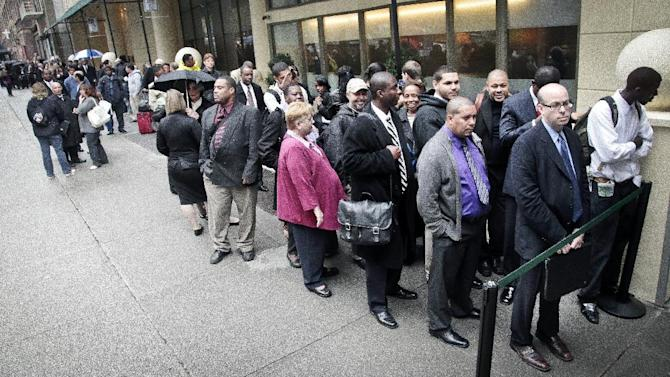 In this Wednesday, Oct. 24, 2012, photo, job seekers wait in line to see employers at a National Career Fairs' job fair in New York. An increase in hiring helped lower unemployment rates in 37 U.S. states last month, the latest indication that the job market is slowly healing.Unemployment rates are now below 7 percent in 23 of the 50 states. The Labor Department says rates rose in seven states in October and were unchanged in six. (AP Photo/Bebeto Matthews)