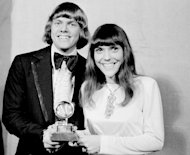 FILE - In this March 17, 1971 file photo, The Carpenters: Richard and Karen, pose with their Grammy during the 13th annual 1970 Grammy Awards in Los Angeles. The brother-sister duo was named best new artist of the year, 1970, and also won as the best contemporary duo or group vocalists for &quot;Close to You.&quot; Hal David, the stylish, heartfelt lyricist who teamed with Burt Bacharach on dozens of timeless songs for movies, television and a variety of recording artists in the 1960s and beyond, died Saturday, Sept. 1, 2012. He was 91. David and Bacharach wrote and composed the lyrics for &quot;Close to You.&quot; (AP Photo/File)