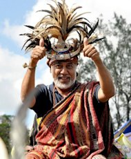 East Timor prime minister Xanana Gusmao gives a thumbs up during the first day of campaign for East Timor's parliamentary election in Lospalos in June 2012. The ruling party of East Timor resistance hero Gusmao on Sunday said it was inviting two smaller political parties to form a coalition government