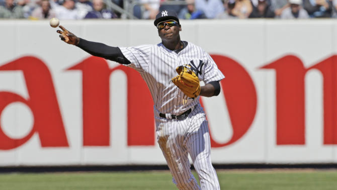 FILE - In this April 6, 2015, file photo, New York Yankees shortstop Didi Gregorius throws to first in the fourth inning of an opening day baseball game against the Toronto Blue Jays in New York. (AP Photo/Kathy Willens, File)