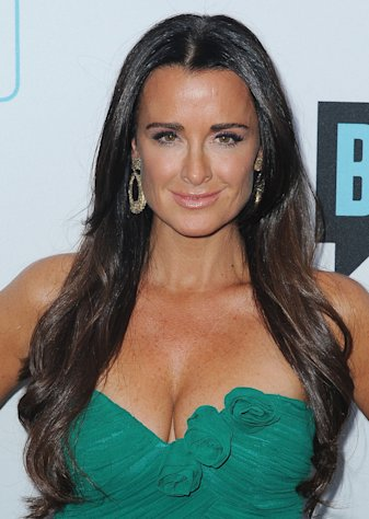 FILE - In this March 30, 2011 file photo, TV personality Kyle Richards arrives at the Bravo Media&#39;s 2011 upfront presentation at The Roosevelt Hotel in Los Angeles. The Real Housewives of Beverly Hills star, mother of four girls and wife of 17 years doles out her brand of no nonsense advice on relationships, fashion and beauty in her new book, &quot;Life Is Not a Reality Show: Keeping It Real with the Housewife Who Does It All.&quot; (AP Photo/Katy Winn, file)