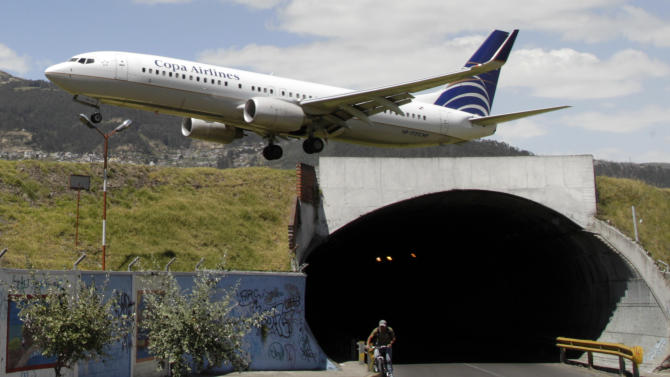In this Jan. 8 2013 photo, a plane approaches the runway at the Mariscal Sucre airport in Quito, Ecuador.  Mariscal Sucre airport sat amid cornfields when it was christened in 1960. Over the years, Quito grew dense around it, turning the airfield into a notoriously nerve-wracking neighbor, with planes booming in and out from 5:45 a.m. until 2 a.m. without rest. That will change on Feb. 19 as Quito moves its airport to an agricultural setting 12 miles (20 kilometers) northeast of the city, joining other cities that have moved, or tried to move, planes further from people. (AP Photo/Dolores Ochoa)