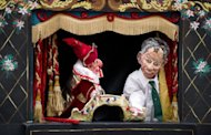 Mr Punch prepares to hit a puppet of former British Prime Minister Tony Blair (R) in a satirical version of the Punch & Judy story during a weekend of performances. Dozens of puppeteers gathered in London on Sunday to celebrate 350 years of the Punch and Judy show, an anarchic English seaside entertainment known for its slapstick and casual violence