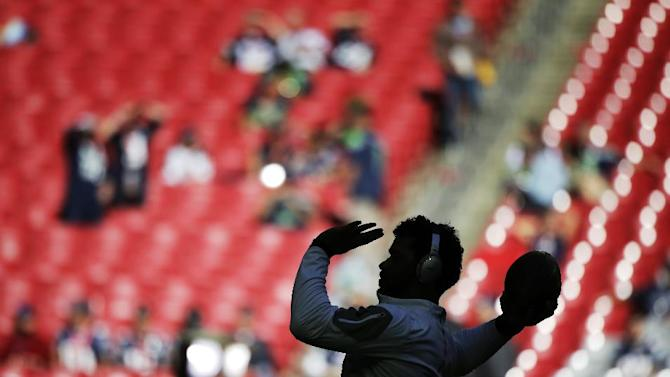Seattle Seahawks quarterback Russell Wilson warms up before the NFL Super Bowl XLIX football game against the New England Patriots Sunday, Feb. 1, 2015, in Glendale, Ariz