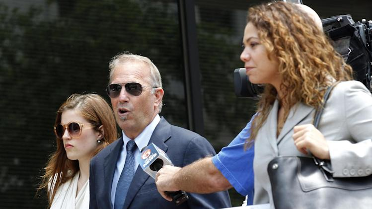 Actor Kevin Costner, center, leaves Federal Court for a lunch break in New Orleans, Monday, June 4, 2012. Stephen Baldwin has sued fellow actor Costner over their investments in a device that BP used in trying to clean up the massive Gulf of Mexico oil spill. The federal lawsuit filed in New Orleans on Wednesday by Baldwin and a friend claims Costner and a business partner duped them out of their shares of an $18 million deal for BP to purchase oil-separating centrifuges from a company they formed after the April 20 spill. ( AP Photo/Bill Haber)