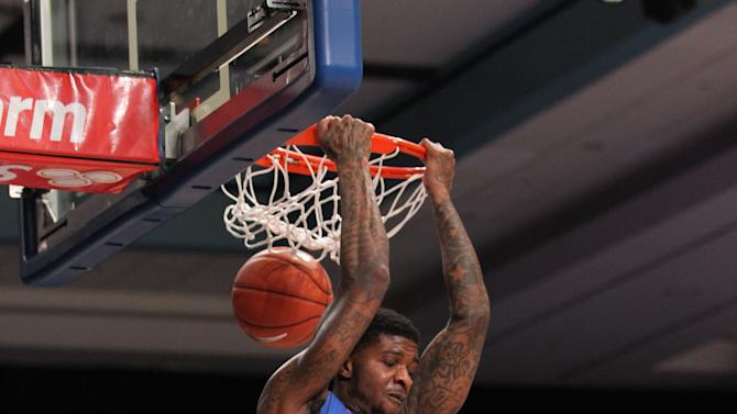 Florida's Chris Walker (23) makes the dunk during their game against UAB at the Battle 4 Atlantis basketball tournament in Paradise Island, Bahamas, Thursday Nov. 27, 2014. (AP Photo/Tim Aylen)