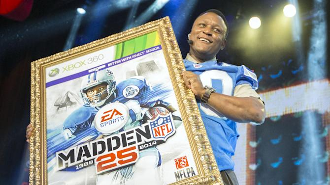 IMAGE DISTRIBUTED FOR EA SPORTS - NFL hall of fame running back Barry Sanders holds up a mock up of the Madden 25 video game cover during the EA Sports Madden NFL 25 Cover Reveal on SportsNation on Wednesday, April, 24, 2013 in New York, New York. (Photo by Chris Park/Invision for EA Sports/AP Images)