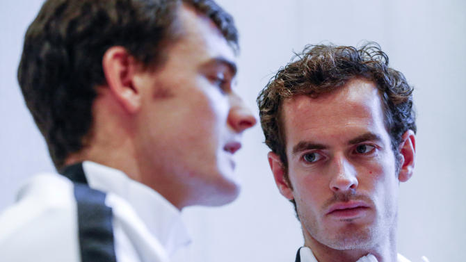 Britain's Andy Murray looks at his brother Jamie during an interview with Reuters Television  in Ghent