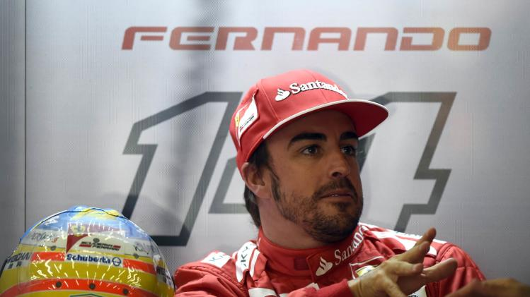 Alonso reacts in the pit during a practice session ahead of the weekend's Belgian F1 Grand Prix in Spa-Francorchamps