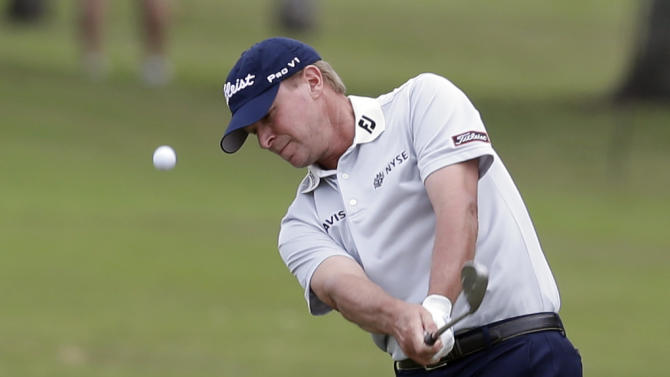 Steve Stricker hits from the fairway on the first hole during the third round of the Cadillac Championship golf tournament Saturday, March 9, 2013, in Doral, Fla. (AP Photo/Wilfredo Lee)
