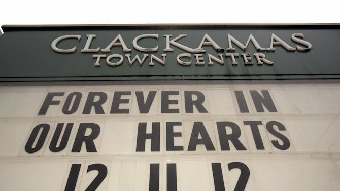 File--In this Dec. 19, 2012, file photo a memorial note graces the marquis at the Clackamas Town Center mall entrance in Portland, Ore., a week after a gunman opened fire in the mall, killing the two people and himself.   Law authorities released a 950-page report, Wednesday, May 1, 2013, on the shooting where a gunman blazed away with a military-style semiautomatic rifle as people did their Christmas shopping. (AP Photo/Don Ryan, file)
