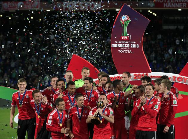 Germany's Bayern Munich Franck Ribery kisses the trophy as he celebrates with his team mates after winning their 2013 FIFA Club World Cup final soccer match against Morocco's Raja Casablanca a