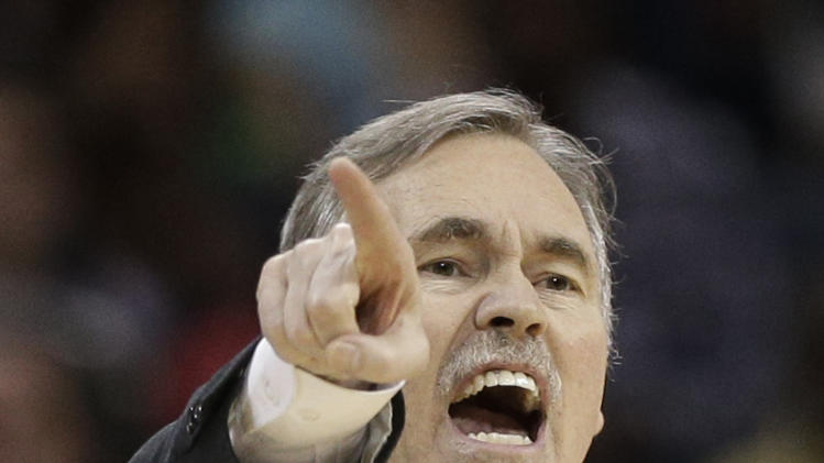 Los Angeles Lakers head coach Mike D'Antoni directs his team against the Charlotte Bobcats during the second half of an NBA basketball game in Charlotte, N.C., Friday, Feb. 8, 2013. The Lakers won 100-93. (AP Photo/Chuck Burton)