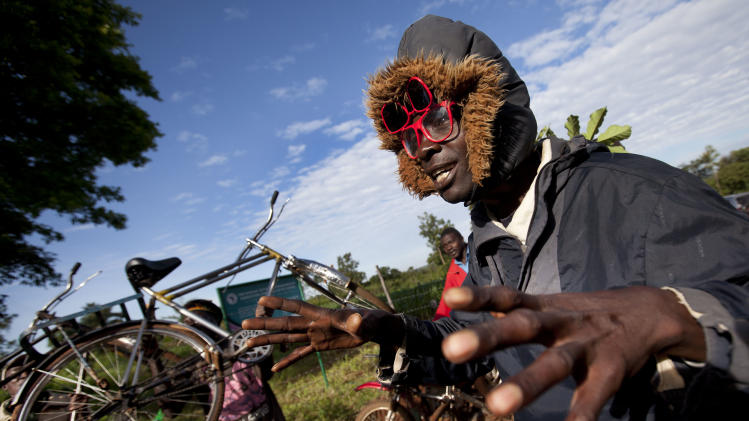 Villagers cheer and raise their bicycles in the air to celebrate Obama's re-election, in the village of Kogelo, home to Sarah Obama the step-grandmother of President Barack Obama, in western Kenya Wednesday, Nov. 7, 2012. (AP Photo/Ben Curtis)