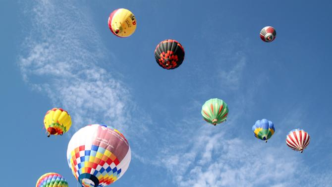 Hot air balloons fill the sky during the Albuquerque International Balloon Fiesta in Albuquerque, N.M., on Saturday, Oct. 2, 2010.  (AP Photo/Susan Montoya Bryan)