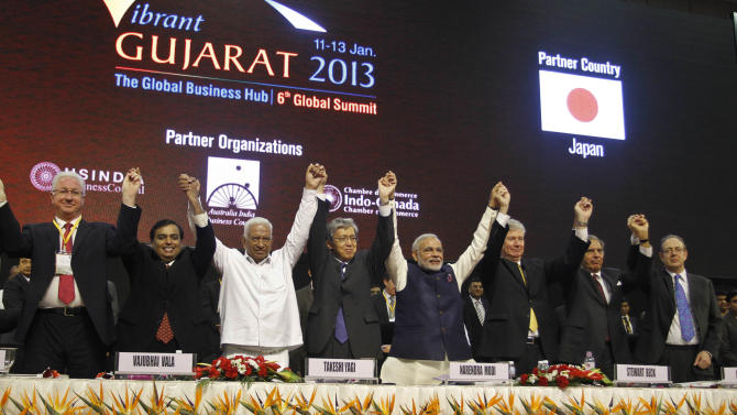 FILE - In this Jan. 11, 2013 file photo, Gujarat Chief Minister Narendra Modi, fourth right, poses with business leaders and other delegates during the inauguration of 6th Vibrant Gujarat Global Summit (VGGS) in Gandhinagar, India. To some, the man in pole position to be India's next prime minister is a visionary reformer, while to others he's an autocrat in bed with big business cronies. Perhaps nowhere are opinions of Narendra Modi more polarized than in Gujarat, the western state he's led for more than decade and that is now touted as a model of prosperity for all of India to emulate.(AP Photo/Ajit Solanki, File)