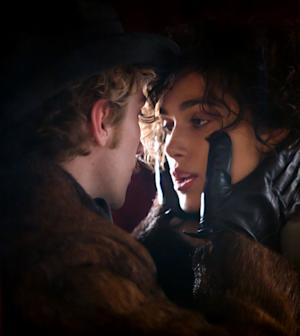 """This film image released by Focus Features shows Aaron Taylor-Johnson, left, and Keira Knightley in a scene from """"Anna Karenina."""" (AP Photo/Focus Features, Laurie Sparham)"""