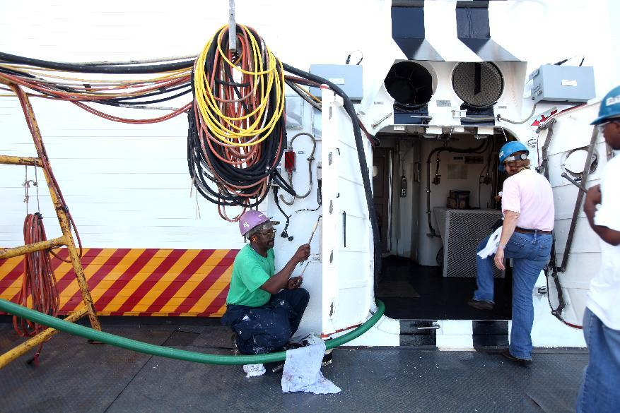 In this photo taken Friday, July 29, 2011, painter Dallas White, left, puts finishing touches on the new Coast Guard National Security Cutter Stratton (WMSL 752) at Ingalls Shipbuilding Friday, July 29, 2011, in Pascagoula, Miss. (AP Photo/Kerry Maloney)