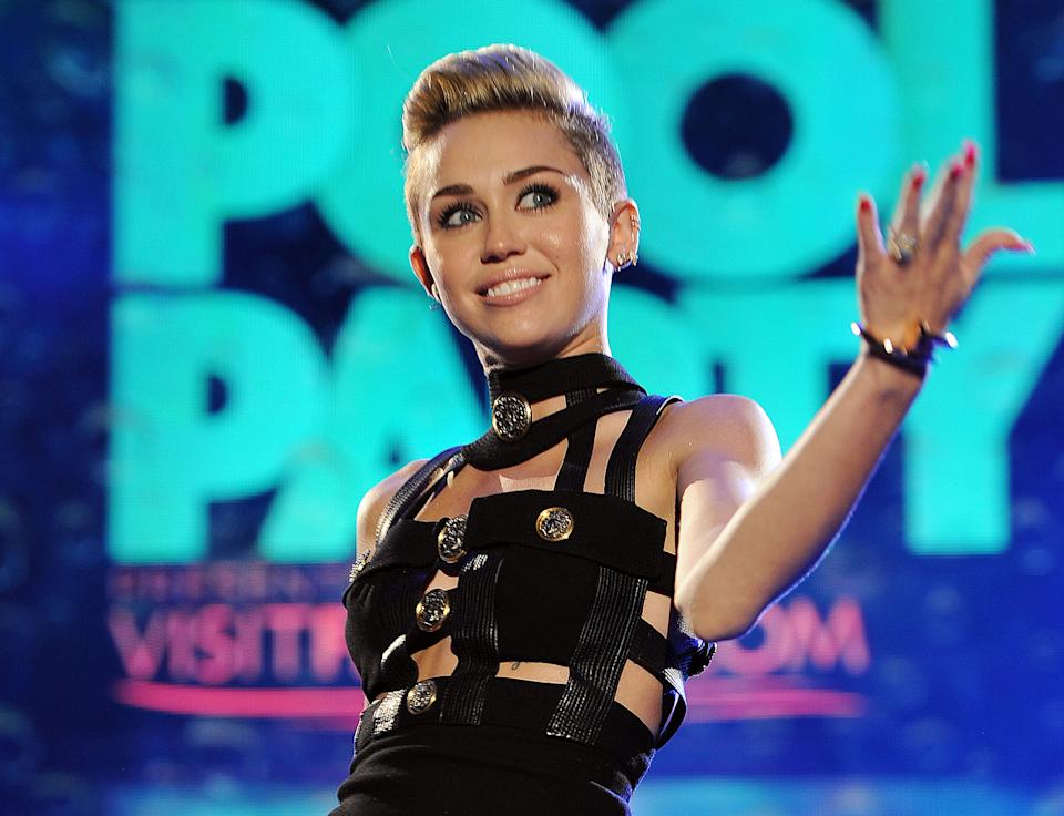 "FILE - This June 29, 2013 file photo shows Miley Cyrus hosting the iHeartRadio Ultimate Pool Party at the Fontainebleau Hotel in Miami. Cyrus' song, ""We Can't Stop,"" is one of the top songs of the summer. (Photo by Jeff Daly/Invision/AP, File)"