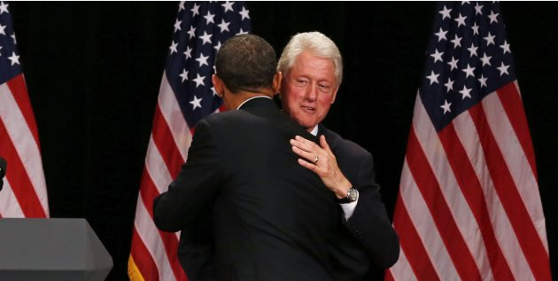 Former U.S. President Clinton hugs U.S. President Obama in New York