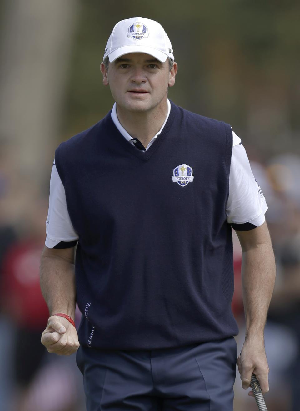 Europe's Paul Lawrie reacts after making a putt on the third hole during a singles match at the Ryder Cup PGA golf tournament Sunday, Sept. 30, 2012, at the Medinah Country Club in Medinah, Ill. (AP Photo/David J. Phillip)