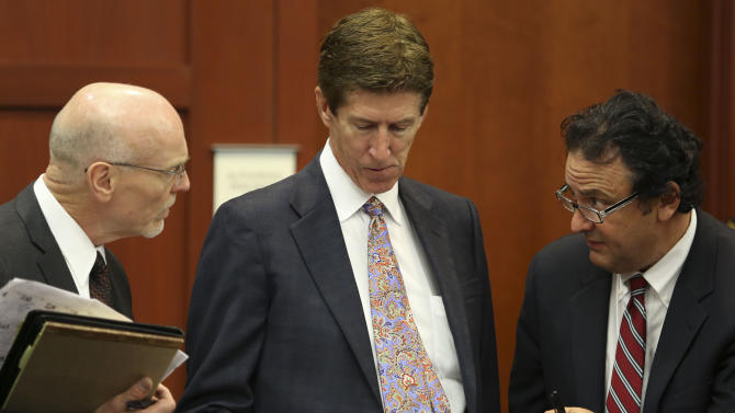 Co-defense attorney Don West, left, defense attorney Mark O'Mara, center, and jury consultant Robert Hirschhorn go over their juror list during the final stages of jury selection in the George Zimmerman trial in Seminole circuit court in Sanford, Fla., Thursday, June 20, 2013. Zimmerman has been charged with second-degree murder for the 2012 shooting death of Trayvon Martin.(AP Photo/Orlando Sentinel, Gary Green, Pool)
