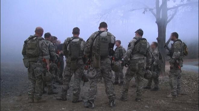 Hostage Rescue Team operators meet following an urban assault training exercise near their headquarters in Virginia.
