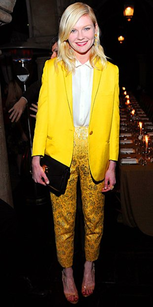 Kirsten Dunst brings the sunshine in a yellow Stella McCartney Jacket and brocade trousers