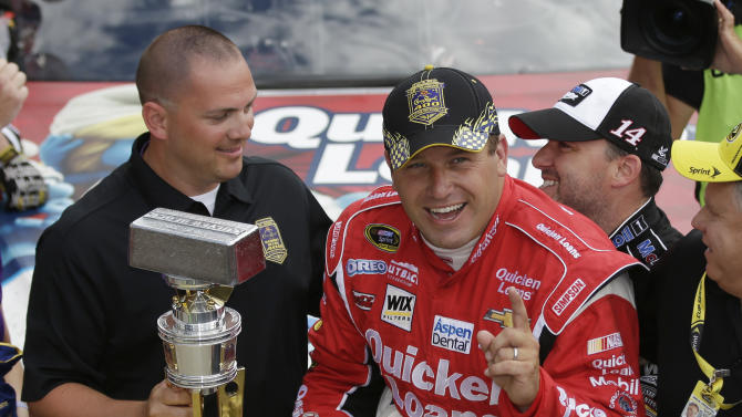 Sprint Cup Series driver Ryan Newman, right, is hugged by team owner and driver Tony Stewart after Newman won the Brickyard 400 auto race at the Indianapolis Motor Speedway in Indianapolis, Sunday, July 28, 2013. (AP Photo/Darron Cummings)