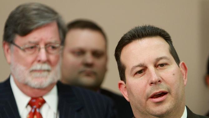 jAttorney Jose Baez, right, lead defense counsel for Casey Anthony, answers questions after his client was found not guilty in her  murder trial, at the Orange County Courthouse, in Orlando, Fla., Tuesday, July 5, 2011.   Looking on, co-counsel Cheney Mason, left.  (AP Photo/Joe Burbank, Pool)