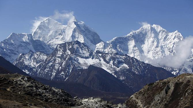 File picture shows a trekker walking in front of Mount Thamserku while on his way back from Everest base camp near Pheriche