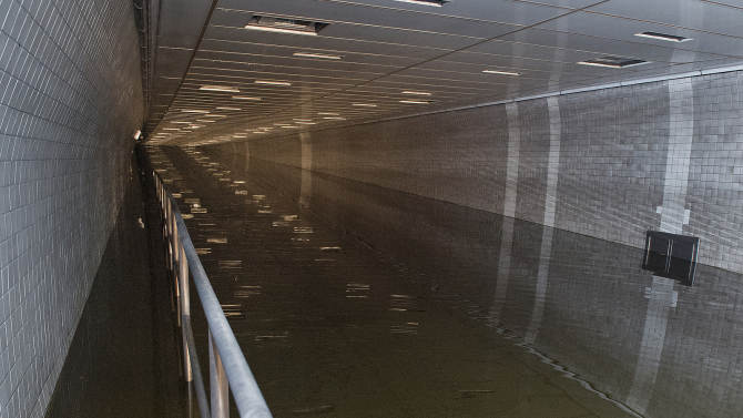 In a photo made available by the Metropolitan Transportation Authority on Tuesday, Oct. 30, 2012 water floods the Hugh L. Carey Tunnel, formerly known as the Brooklyn Battery Tunnel during superstorm Sandy, in New York. Nearly 4,000 feet of the Brooklyn-Battery Tunnel remained heavily flooded Tuesday morning. (AP Photo/Metropolitan Transportation Authority, Patrick Cashin)