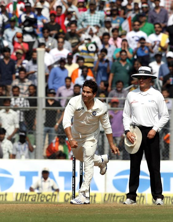 Cricket legend Sachin Tendulkar in action during the 3rd day of the 2nd Test Match between India and West Indies at Wankhede Stadium in Mumbai on Nov.16, 2013. (Photo: IANS)