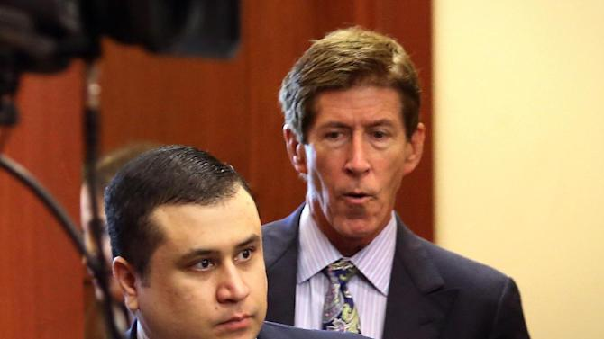 "George Zimmerman, defendant in the killing of Trayvon Martin, arrives in Seminole circuit court, in Sanford, Fla., with his attorney Mark O'Mara, right, for a pre-trial hearing, Tuesday, April 30, 2013.  Zimmerman says he agrees with his attorneys' decision not to seek an immunity hearing under the state's ""Stand Your Ground"" self-defense law. (AP Photo/Orlando Sentinel, Joe Burbank, Pool)"
